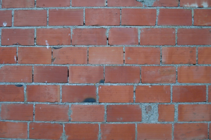 """Brick wall"" by allispossible.org.uk Licensed under CC-BY 2.0 Original source via Flickr"